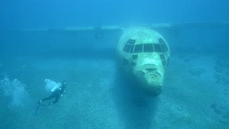Underwater-footage-of-scuba-divers-exploring-a-sunken-plane-in-the-Red-Sea-near-Aqaba-Jordan