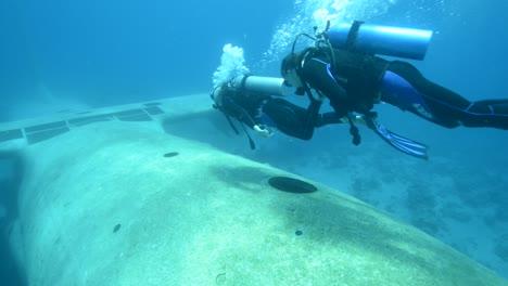 Underwater-footage-of-scuba-divers-exploring-a-sunken-plane-in-the-Red-Sea-near-Aqaba-Jordan-1