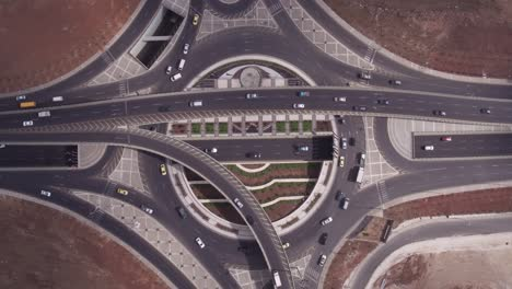 Aerial-Straight-Down-Of-Traffic-Circle-Or-Roundabout-With-Car-Traffic-Amman-Jordan-6