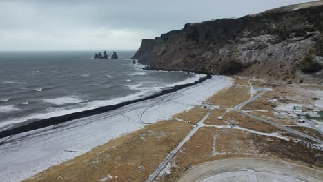 An-vista-aérea-view-shows-the-Reynisdrangar-Sea-cresting-on-Vik-Iceland