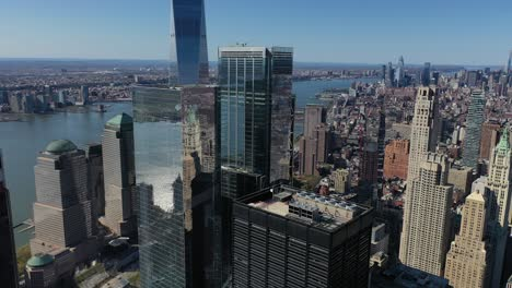 Beautiful-rising-daytime-aerial-of-the-Freedom-Tower-in-the-financial-district-of-Manhattan-New-York-City