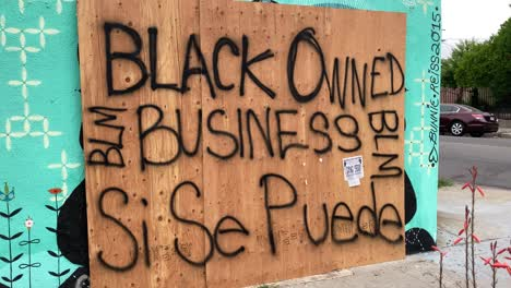 A-boarded-up-Los-Angeles-storefront-is-identified-as-a-Black-Owned-Business-during-rioting-and-looting-Black-Lives-Matter-protests-