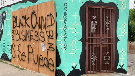 A-boarded-up-Los-Angeles-storefront-is-identified-as-a-Black-Owned-Business-during-rioting-and-looting-Black-Lives-Matter-protests-1