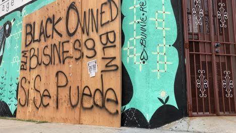 A-boarded-up-Los-Angeles-storefront-is-identified-as-a-Black-Owned-Business-during-rioting-and-looting-Black-Lives-Matter-protests-2
