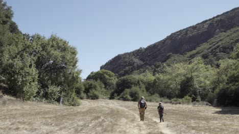 A-father-and-son-bond-their-friendship-and-relationship-while-walking-on-a-wilderness-trail-Gaviota-Coast-California-3