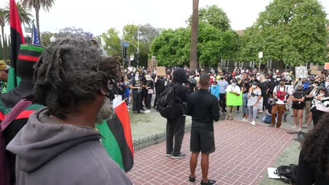 Protesters-Listen-To-Speaker-During-A-Black-Lives-Matter-Blm-March-In-Los-Angeles-Following-The-George-Floyd-Murder