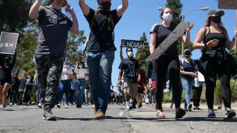 Marching-Protesters-Activists-During-A-Black-Lives-Matter-Blm-March-In-Ventura-California-With-Signs