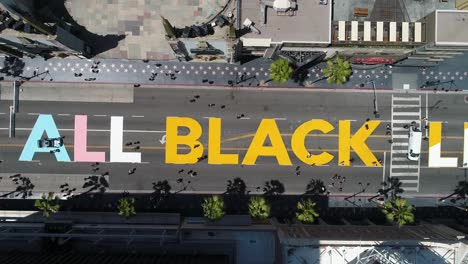 High-Aerial-Over-The-All-Black-Lives-Matter-Blm-Mural-On-Street-Top-Down-Hollywood-Blvd-Los-Angeles-California-1