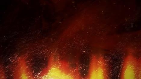 Tema-Cinematográfico-Con-Lava-Al-Rojo-Vivo-Y-Cámara-De-Movimiento-Sobre-Fondo-Oscuro-1