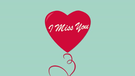 Animated-closeup-I-Miss-You-text-and-motion-romantic-red-ballon-heart-on-Valentines-day-background