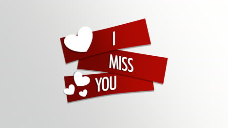 Animated-closeup-I-Miss-You-text-and-motion-romantic-small-white-hearts-on-Valentines-day-background