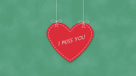 Animated-closeup-I-Miss-You-text-and-motion-romantic-big-red-heart-on-Valentines-day-background