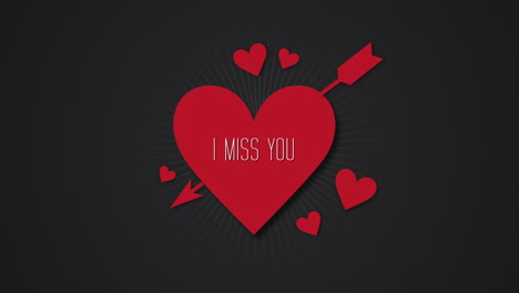 Animated-closeup-I-Miss-You-text-and-motion-romantic-big-red-heart-with-arrow-on-Valentines-day-background