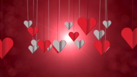 Animation-closeup-motion-small-romantic-heart-on-red-Valentines-day-shiny-background