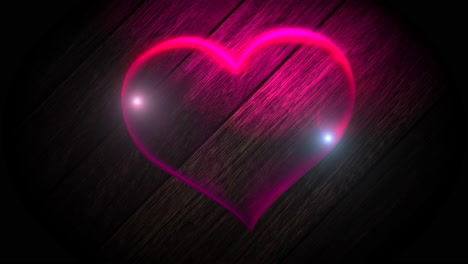 Animation-closeup-motion-big-neon-romantic-heart-on-wall-background-Valentines-day-holiday