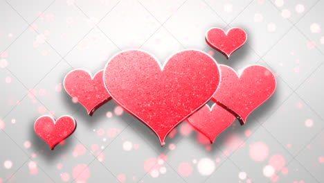 Animation-closeup-motion-big-and-small-romantic-hearts-on-white-shiny-Valentines-day-background