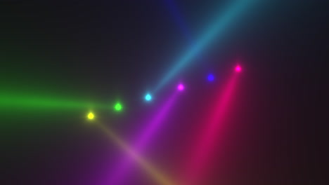Animation-motion-colorful-glowing-spotlight-beams-on-dark-background-in-stage-4