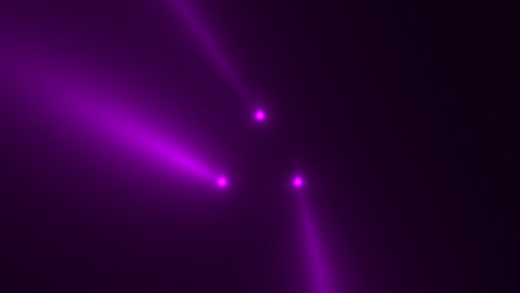 Animation-motion-purple-glowing-spotlight-beams-on-dark-background-in-stage