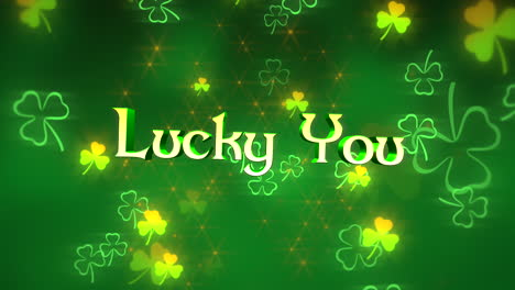 Animation-closeup-Lucky-You-text-and-motion-small-green-shamrocks-with-glitters-on-Saint-Patrick-Day-shiny-background
