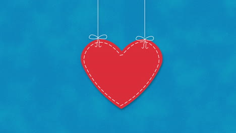 Animated-closeup-romantic-red-heart-on-blue-Valentines-day-background