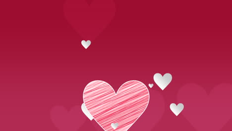 Animated-closeup-romantic-red-big-and-small-hearts-on-red-Valentines-day-background-
