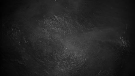 Motion-and-fly-particles-on-cinematic-background-with-grey-grunge-texture