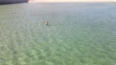 Swimming-At-Empty-Beach-After-Covid19