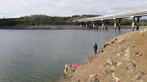 Young-Man-Fishing-At-Lake