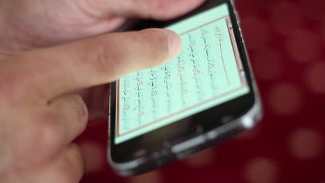 Young-Muslim-Reading-Quran-On-Smart-Phone