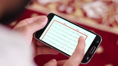 Muslim-Man-Reading-Quran-On-Mobile-Phone