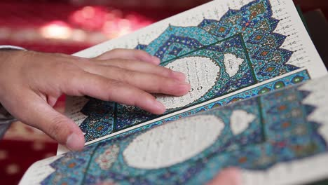 Young-Muslim-Man-Reading-Quran-In-Mosque-2