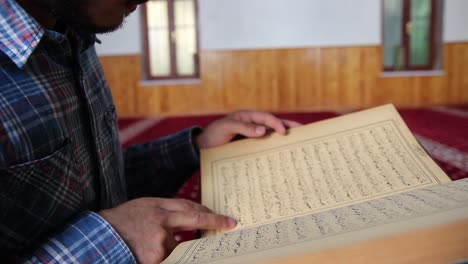 Young-Muslim-Man-Reading-Quran-In-Mosque-8