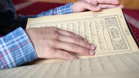 Young-Muslim-Man-Reading-Quran-In-Mosque-10