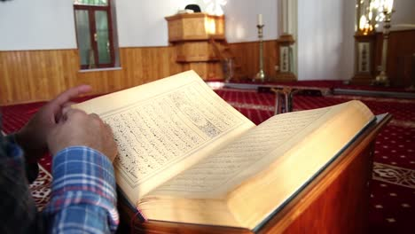 Young-Muslim-Man-Reading-Quran-In-Mosque-15