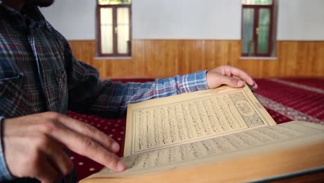 Young-Muslim-Man-Reading-Quran-In-Mosque-19