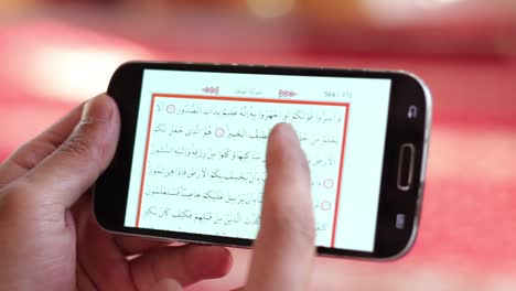 Young-Muslim-Man-Reading-Quran-On-Mobile-Device-1