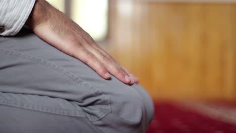 Muslim-Kneeling-in-Prayer-In-Mosque