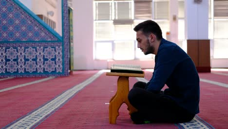 Youth-Reads-Quran-In-Mosque