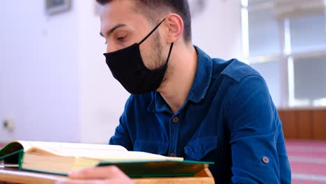 Young-Muslim-Wears-A-Mask-And-Reads-The-Quran-In-Mosque