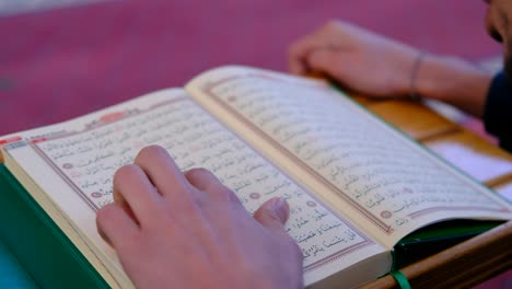 Young-Muslim-Wearking-A-Mask-Reading-The-Quran-In-Mosque