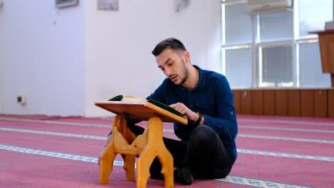 Man-Reading-Quran-In-Mosque-2
