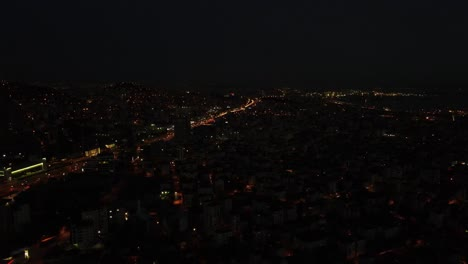 Vista-Aérea-De-La-Ciudad-Urbana-Nocturna