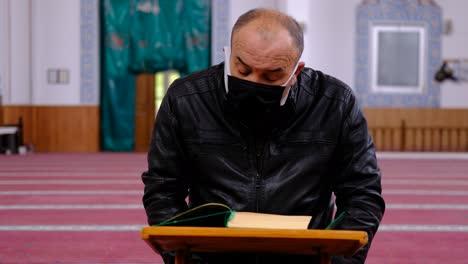 Old-Masked-Man-Reading-Quran-During-Ramadan