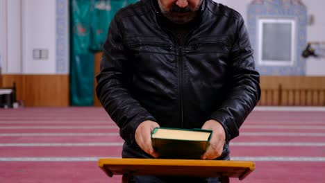 Masked-Man-Reading-The-Quran-in-Mosque