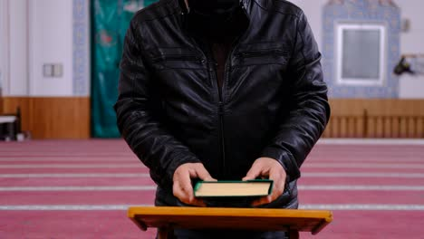 Old-Maksed-Man-Reads-The-Quran-In-Mosque