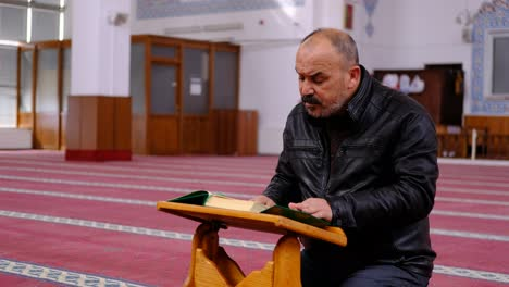 Man-Reading-Quran-In-Mosque