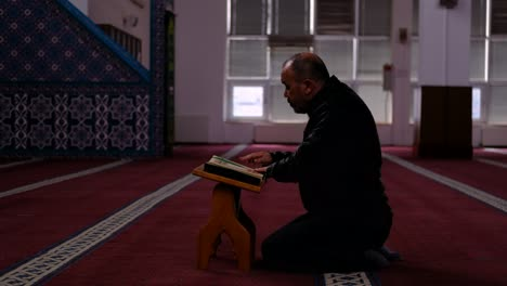 Middle-Age-Man-Read-Quran-Mosque-1