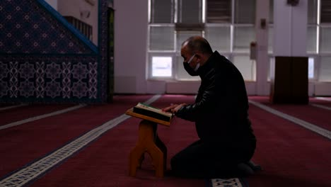 Adult-Masked-Man-Reads-The-Quran-In-Mosque