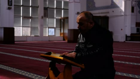 Middle-Age-Man-Reads-The-Quran-In-Masjid