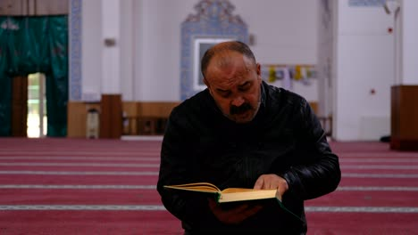 Middle-Age-Man-Reads-Quran-In-Mosque-2